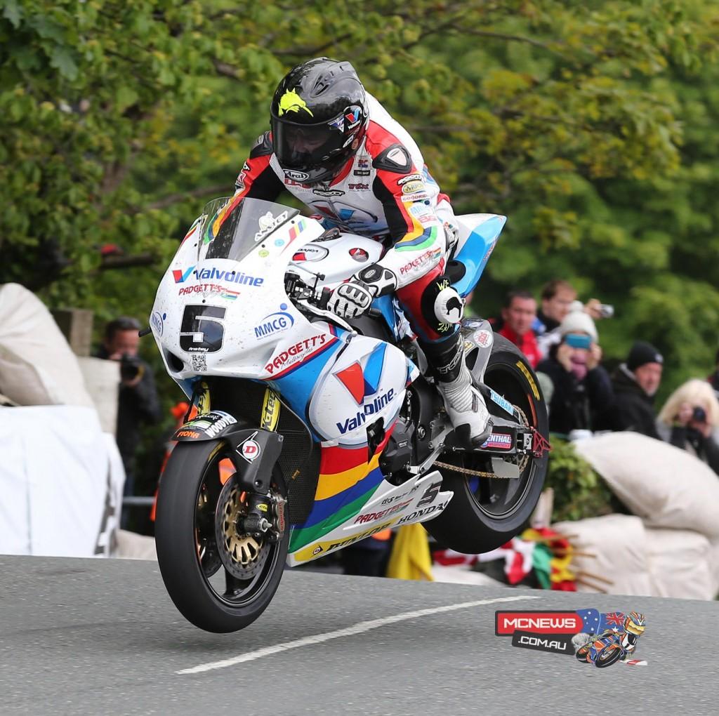 Isle of Man TT fuelled by Monster Energy RST Superbike race winner Bruce Anstey jumps Ballaugh Bridge