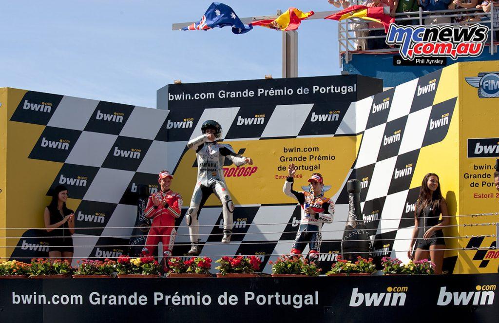 Jorge Lorenzo celebrates his win on the podium.