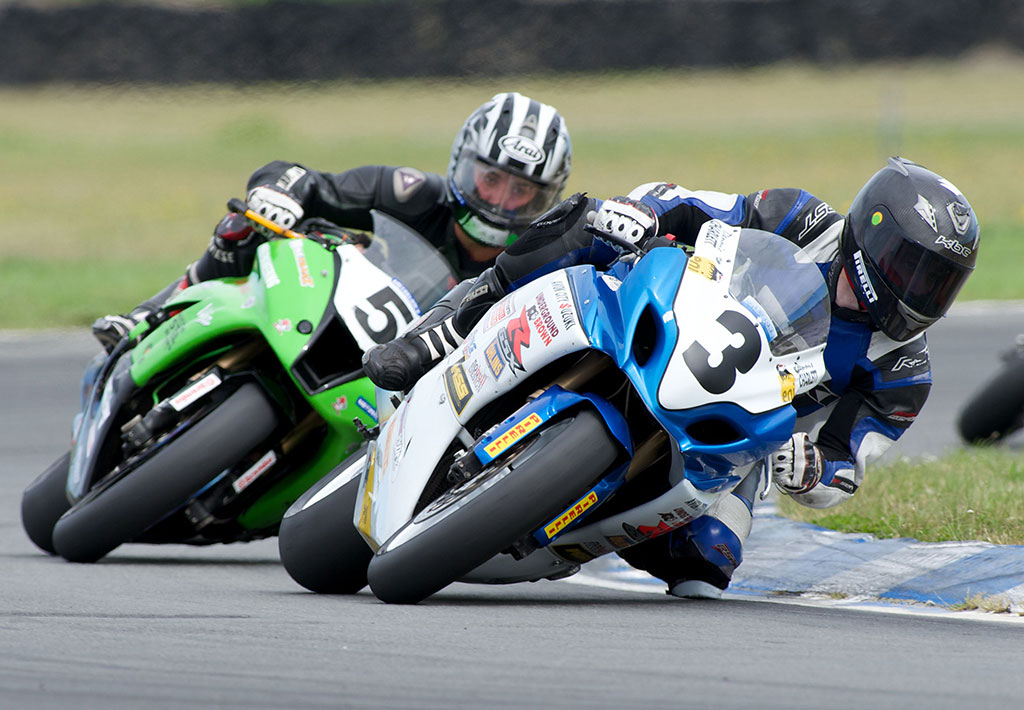 Dennis Charlett leading Nick Cole during Superbike racing at Ruapuna. Photo by Andrew Bright.