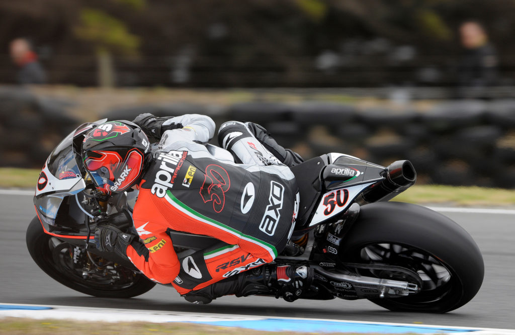 """Sylvain Guintoli: """"This winter was hard. After 4 months without riding a bike and only a little bit of testing I was concerned about my physical conditions. But my Aprilia worked very well and it is no secret that this is one of our favourite tracks. I really had a lot of fun today. It's a shame I couldn't get my time down to 1'29 - that would have been fantastic. The important thing is that we grew and developed throughout the weekend. My shoulder isn't giving me any problems so tomorrow I'll be able to push hard since we've also got an excellent race pace. I expect to have two good races. There are a lot of riders with good pace, but I hope to be able to use my RSV4's power to bring home the win""""."""