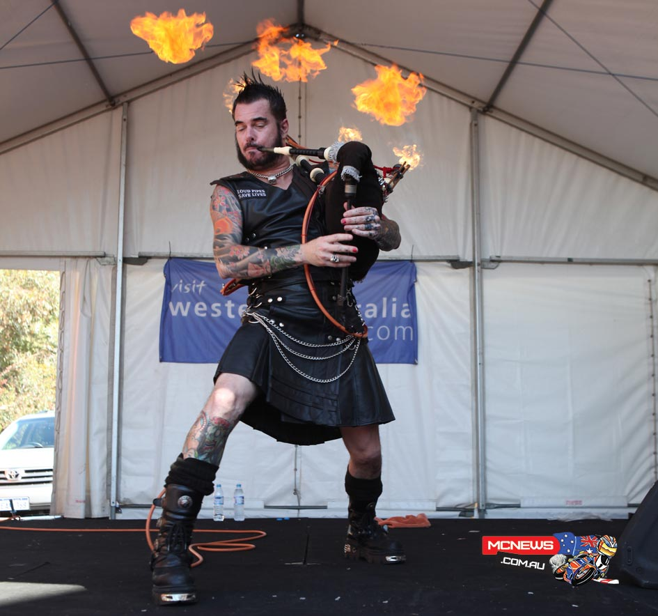 The Badpiper performing live on stage, complete  with his leather kilt and flaming bagpipes