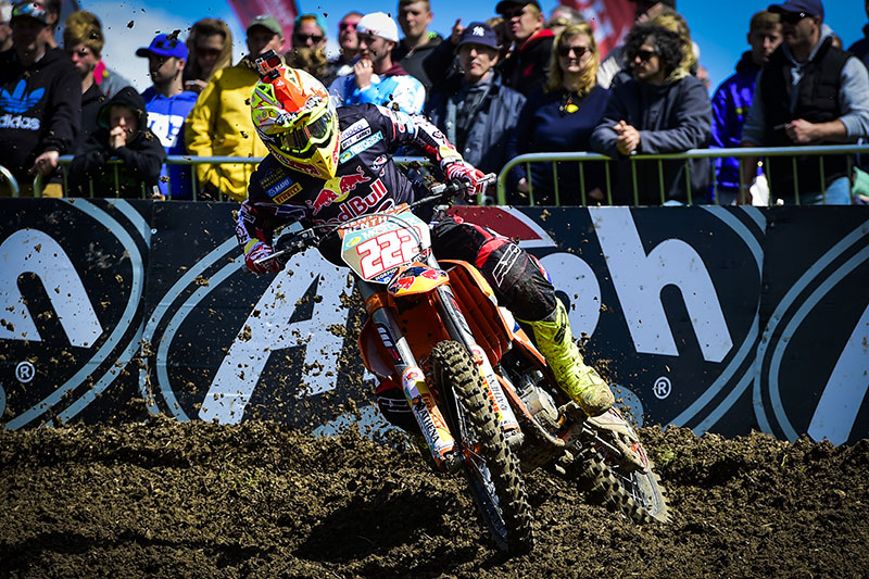 Antonio Cairoli (KTM) ended up winning the premier MXGP class from Clement Desalle (Suzuki) and Jeremy Van Horebeek (Yamaha) after two motos run in sunny but windy conditions near England's south coast.