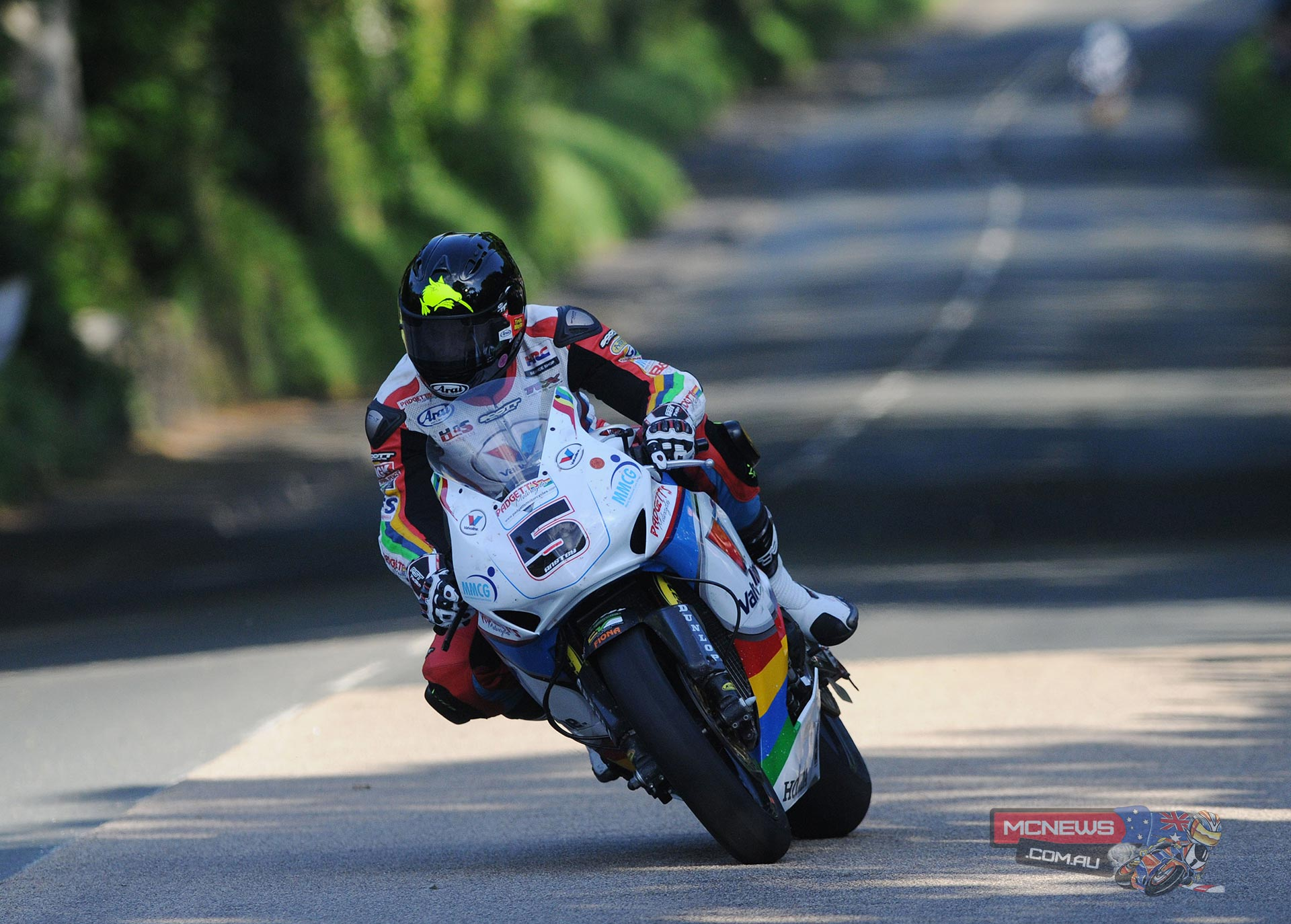 Clear blue skies and sunshine on Monday evening meant the 2014 Isle of Man TT Races, fuelled by Monster Energy, got underway at last and Bruce Anstey set the pace at 127.473mph just edging out fellow Honda rider John McGuinness whose best lap was 126.355mph.