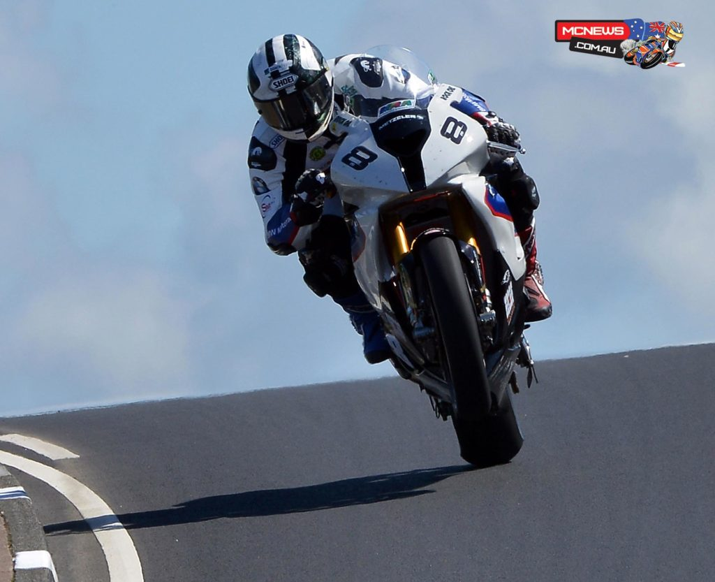 Michael Dunlop stormed to Superbike pole position on the Motorrad/Hawk BMW in blistering sunshine during the final qualifying session of the Vauxhall International North West 200 overnight.