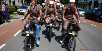 Celebrating the visit to one of the most historic venues in MotoGP™ the riders dressed in some antique racing gear and rode VéloSolex bicycles around the town.