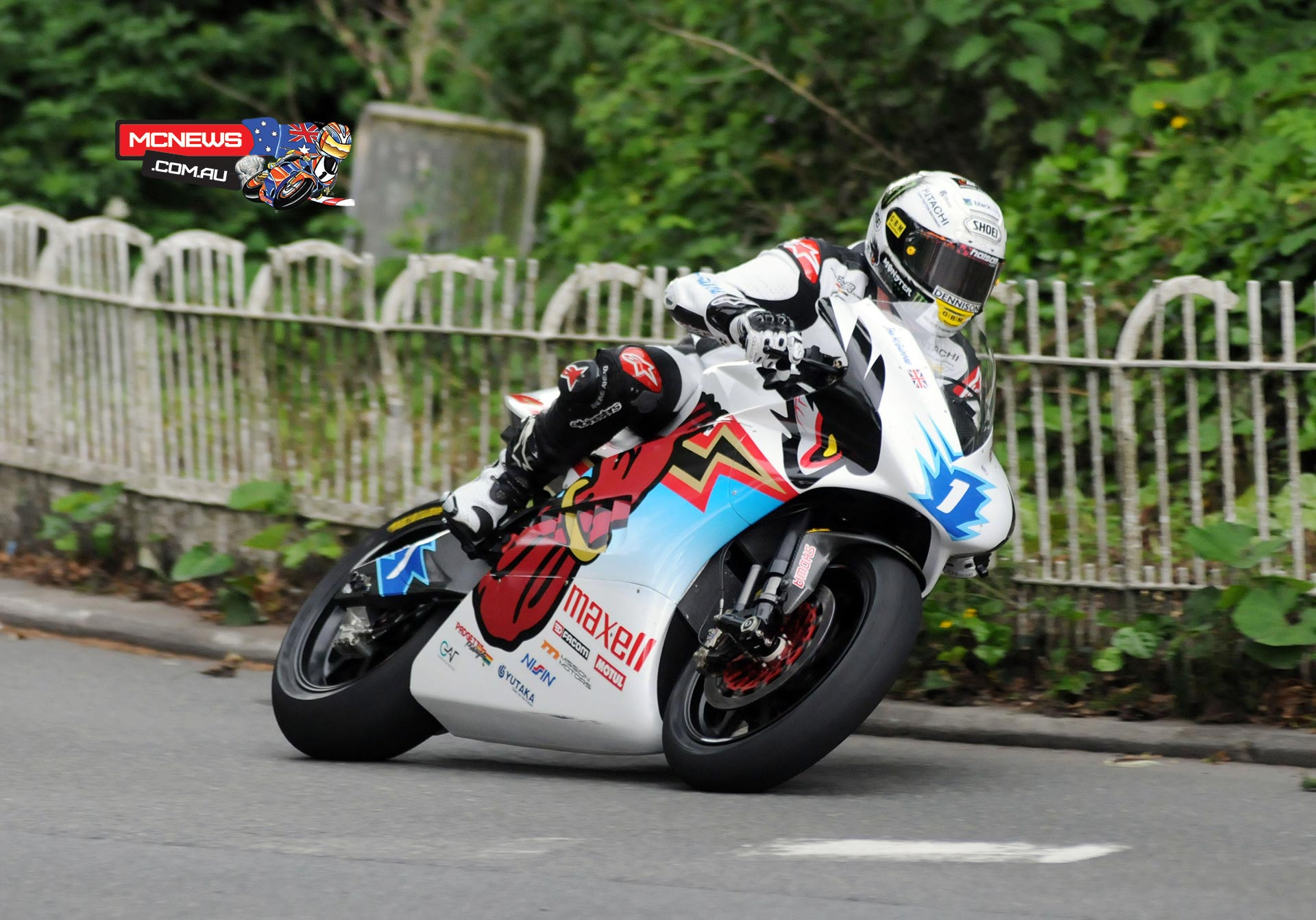 John McGuinness won his 21st TT race on Wednesday morning when he took the SES TT Zero race in record-breaking style.
