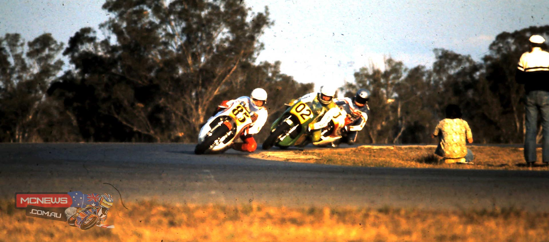 Warren Willing, Gregg Hansford and John Woodley in the same order at CC Corner at the bottom of the straight. Willing had established a small break at this stage due to traffic.