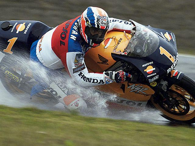Mick Doohan splashing his way around