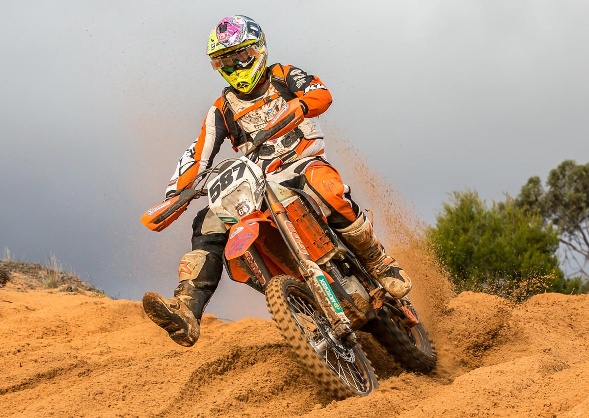 "Toby Price on winning the 2014 Hattah Desert Race: ""I'm stoked with the win, the KTM Desert Team worked really hard and well. Our only little bit of drama came at the end of lap three when we thought we were going to make two laps no worries, but I ran out of fuel with probably two kays to go. I tipped the bike on its side to get more fuel in it and it got to about 50 metres off the line and I had to run it the rest, so it was a bit of a close call, but we came out on top so that's what matters. Overall it was a good result for the whole team and I was stoked to see Louis get on the podium at his first desert race, and Ivan did well also."""