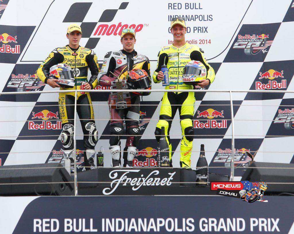 Maverick Viñales and Dominique Aegerter join race winner Mika Kallio on the podium.