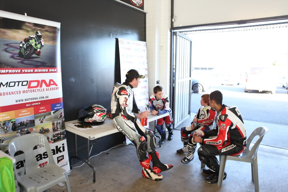 Grand Prix legend Garry McCoy passes on some tips to the youngstersKids getting ready to go on track at Sydney Motorsport Park