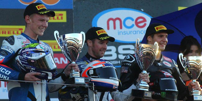 Alastair Seeley capitalised on the woes of the Smiths Racing Triumph team-mates Billy McConnell and Graeme Gowland in the Motorpoint British Supersport Championship Sprint race at Silverstone to score his seventh victory of the season.