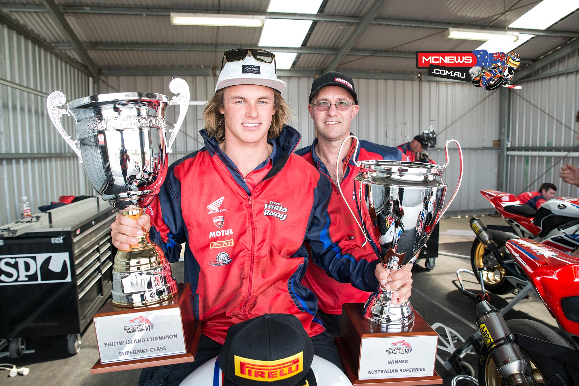 Josh Hook and Team Honda Racing's Paul Free celebrate the spoils of victory