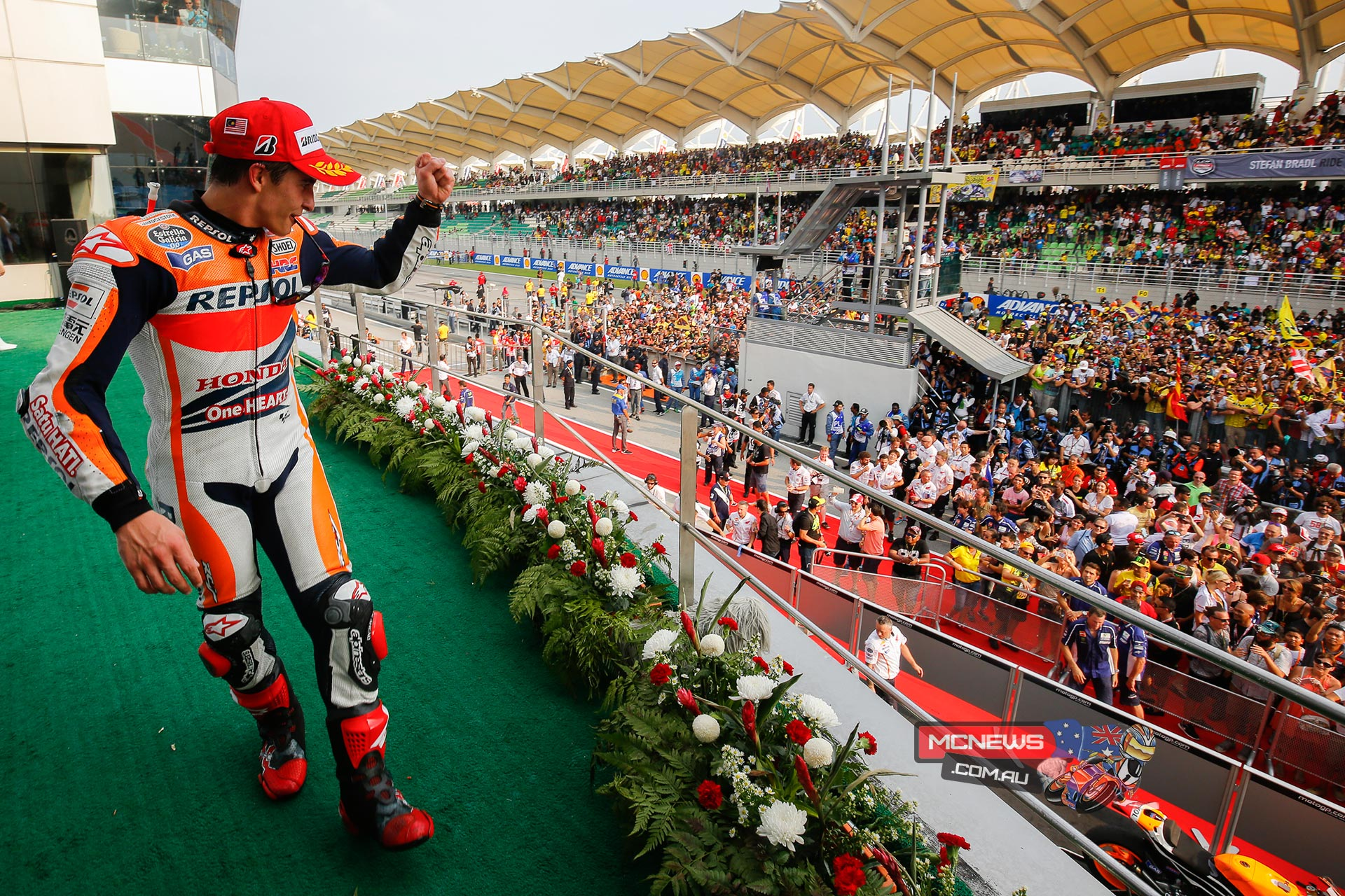 The MotoGP race at the Shell Advance Malaysian Motorcycle Grand Prix was won by MotoGP™ World Champion Marc Marquez in the scorching afternoon heat at Sepang, with Valentino Rossi and Jorge Lorenzo also on the podium.