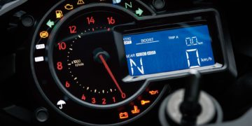 """The new instrumentation design combines a full digital LCD screen with an analogue-style tachometer. LCD screen uses a black/white reverse display (white characters on a black background), contributing to the high-quality image. In addition to the digital speedometer and gear position indicator, display functions include: odometer, dual trip meters, current mileage, average mileage, fuel consumption, coolant temperature, boost indicator, boost (intake air chamber) temperature, stopwatch (lap timer), clock and the Economical Riding Indicator. Tachometer design uses an actual needle, but the black dial """"face"""" looks blank until the engine speed increases. Backlit rpm numbers light up to chase the tachometer needle as it moves around the dial. Compact new handle switch design allows all instrument functions to be controlled from the handles."""