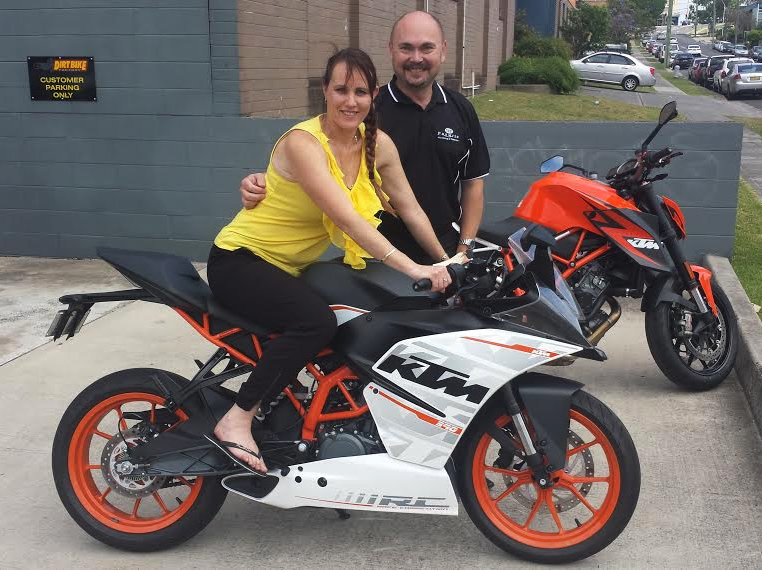 The winner of the KTM's spectacular new RC 390, Carolyn Prem and her partner Zarko.