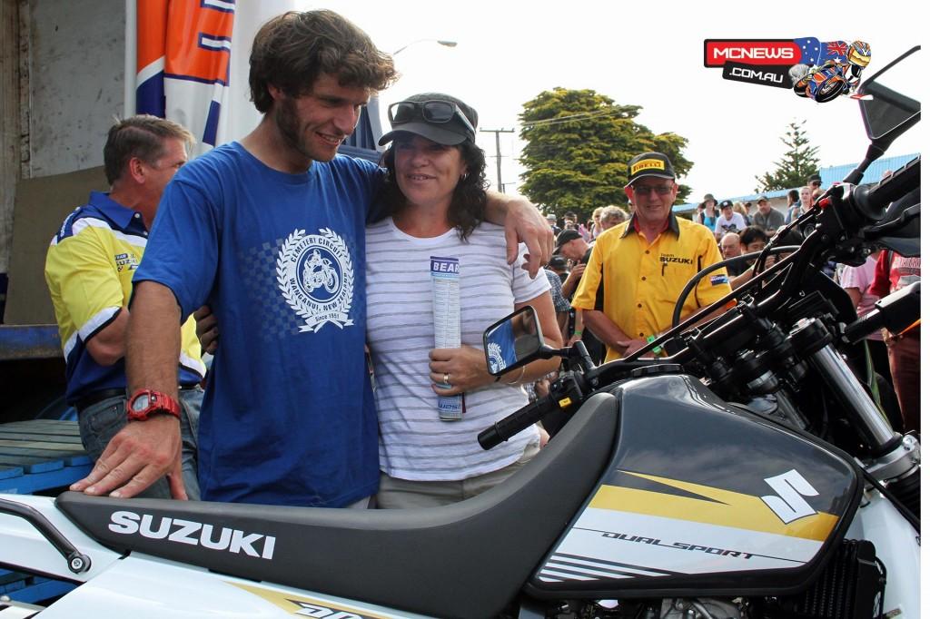 Guy Martin with $8,999 Suzuki DR650 SE winner Betty Fraser, of Bulls. Photo by Terry Stevenson
