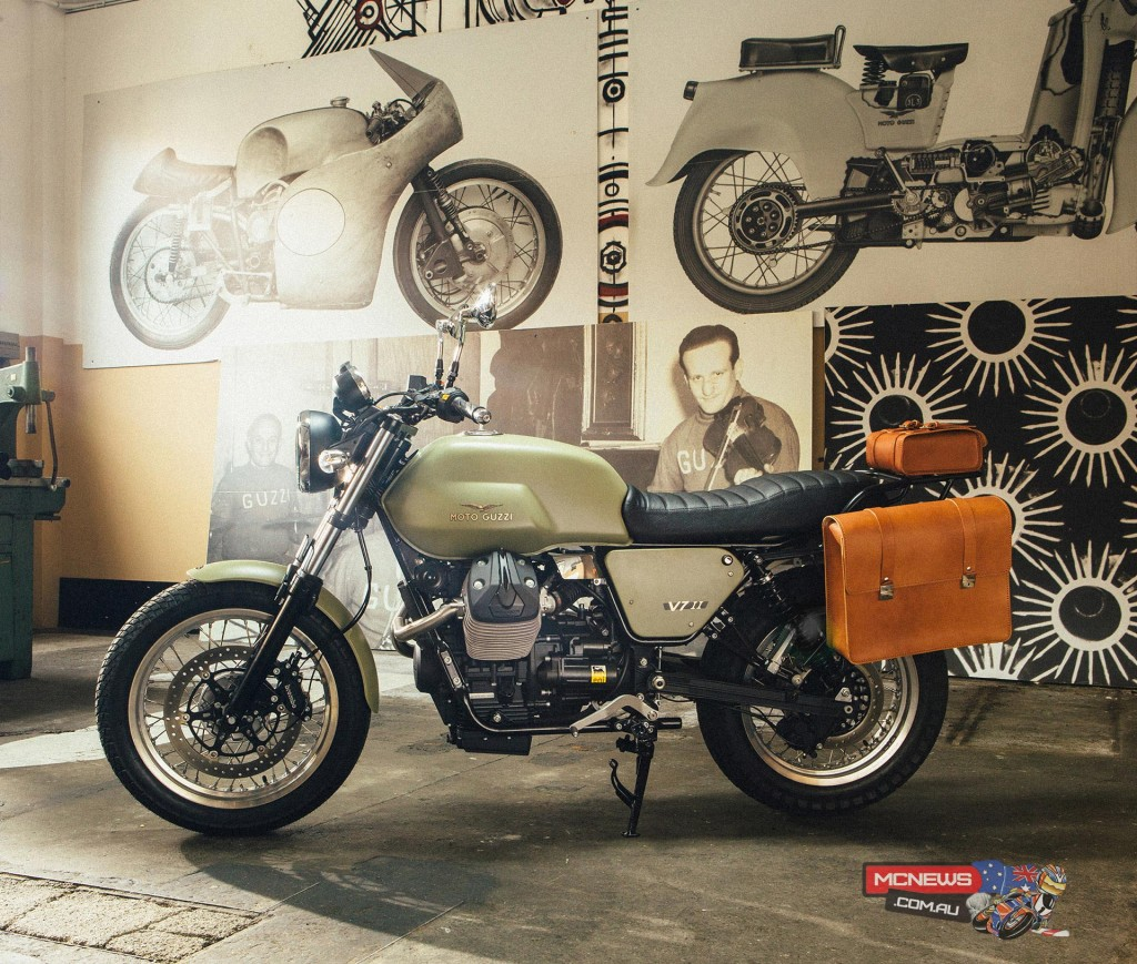 """Legend Kit: These accessories have been designed to recreate Moto Guzzi history, the Legend is a modern interpretation of the Moto Guzzi Alce, a bike used by the Italian Army. The accessories that make up the Legend include a dark satin finish high """"two-in-one"""" silencer, olive green fuel tank, side fairings and mudguard. To finalise the Legend Kit a cross brace handlebar, black luggage rack, larger seat and natural leather side bags have also been included."""