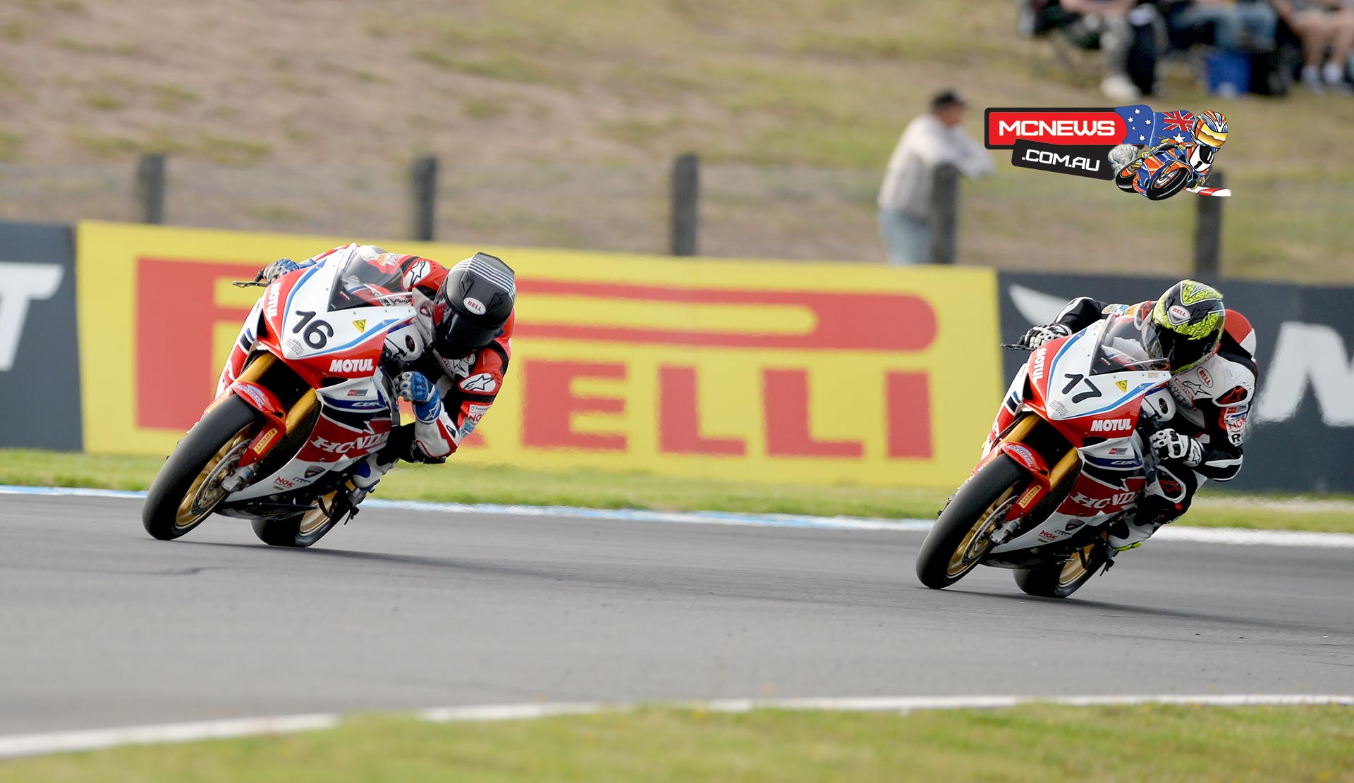 Josh Hook took the opening race win in ASBK season 2015 from Troy Herfoss by 0..099 of a second at Phillip Island
