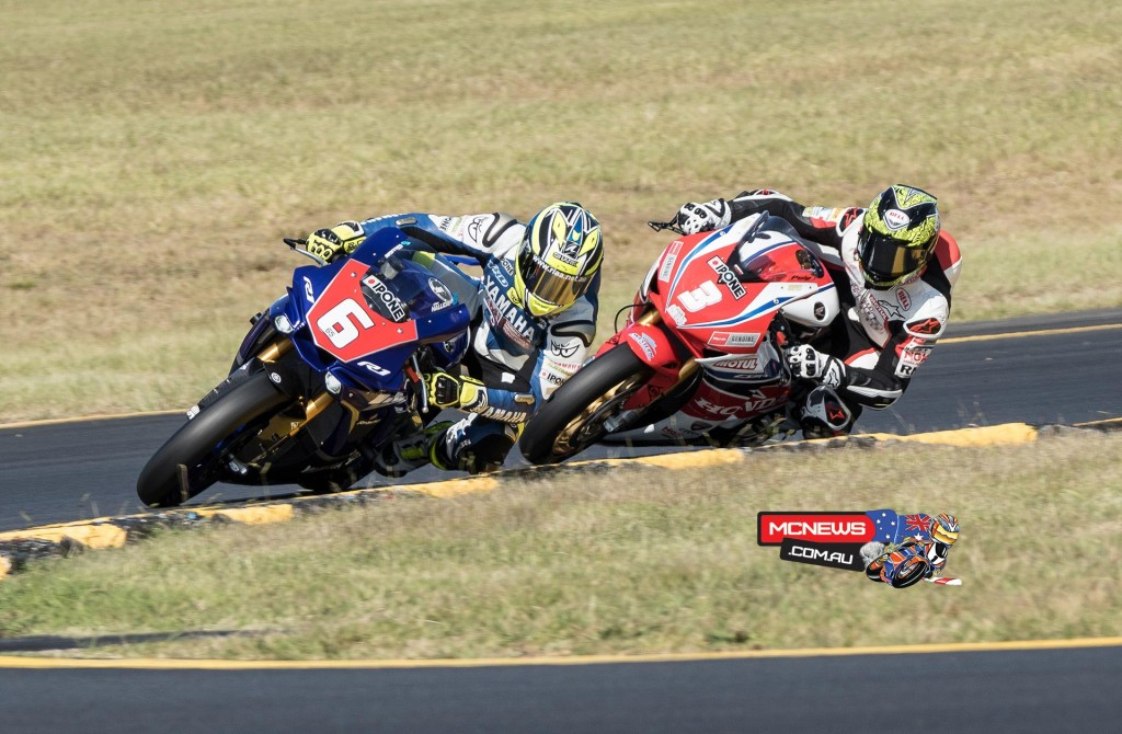 Cru Halliday leads Troy Herfoss early in race one