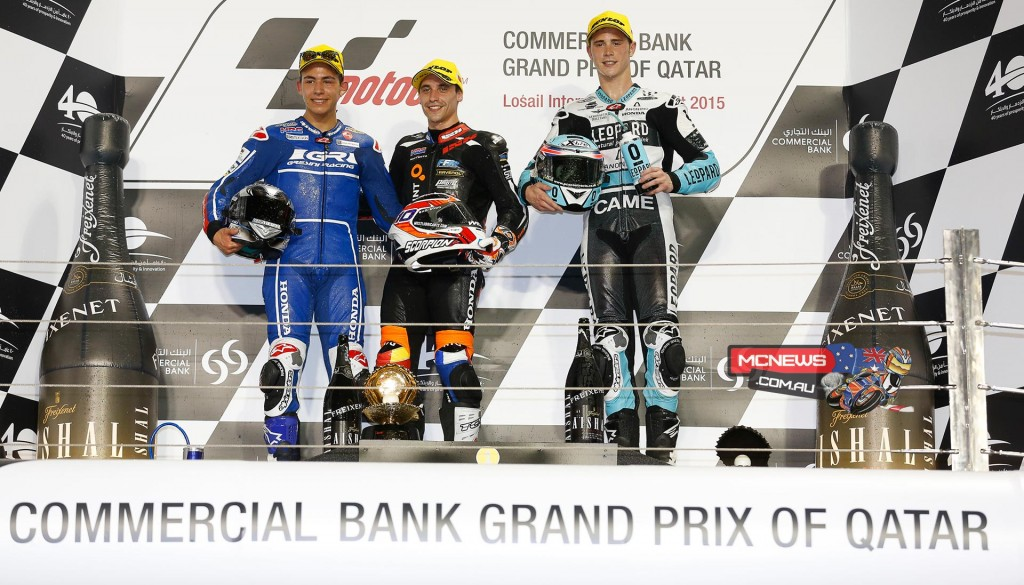 Honda's Alexis Masbou took the first race win of the 2015 Moto3 season in Qatar, ahead of Bastianini and Kent.