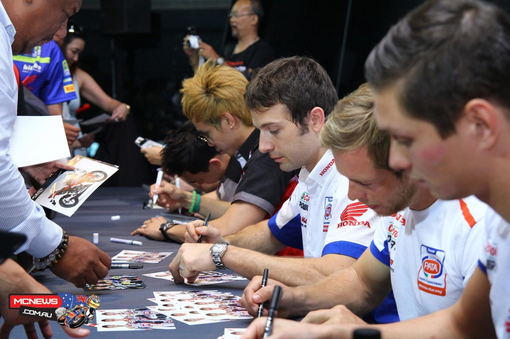 Pata Honda riders sign for fans in Thailand