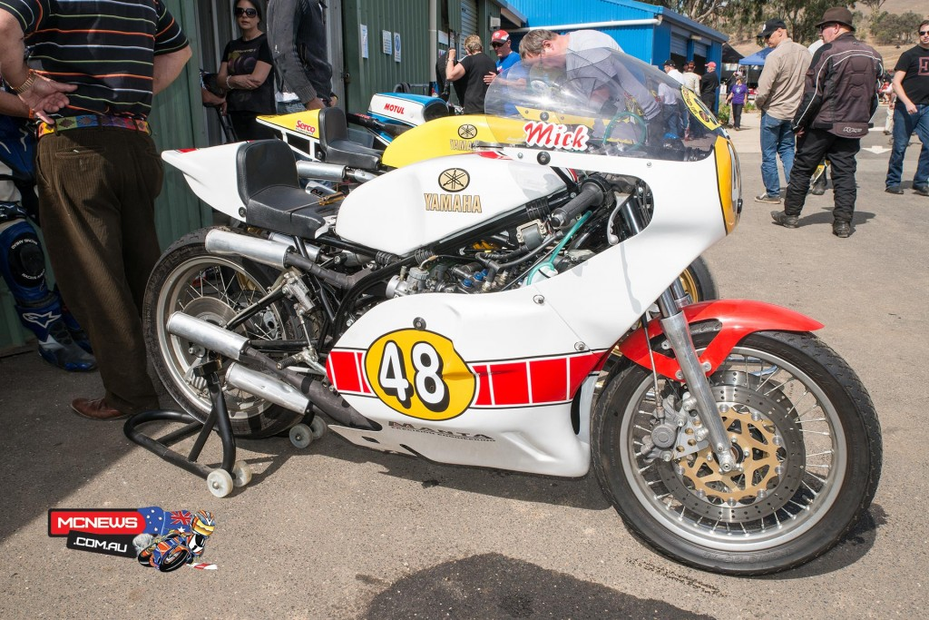 A couple of tasty two-stroke TZ Yamaha's in front of an equally tasty RG500 Suzuki