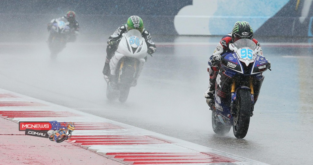 Yamaha-mounted JD Beach (95) leads Bobby Fong's (50) Triumph en route to winning the soaking-wet Supersport final at COTA. Photography By Brian J. Nelson.