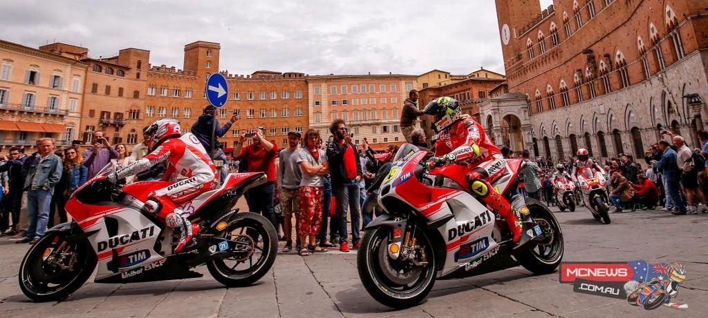 A. Dovizioso (ITA) and A. Iannone (ITA) along with Y. Hernández (COL) and D. Petrucci (ITA) in Piazza del Campo in Siena.