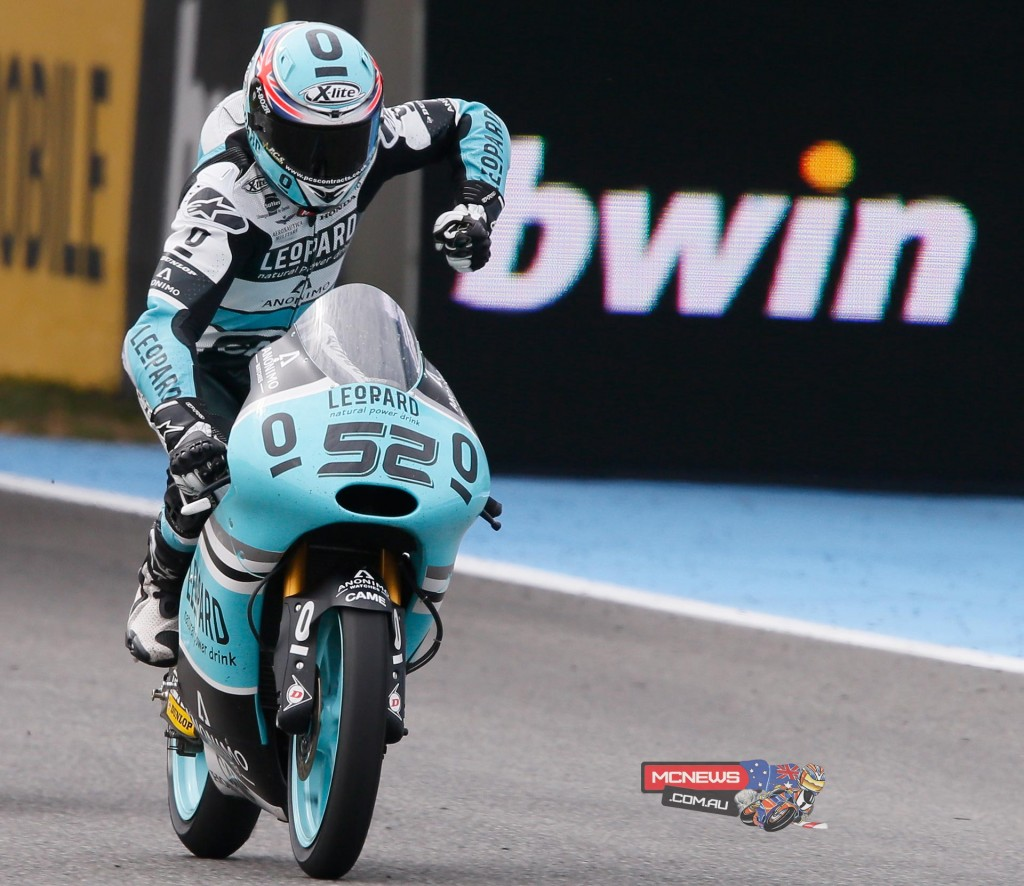 Leopard Racing's Danny Kent won his third Moto3 race in a row, in an epic last lap scrap with Fabio Quartararo and Miguel Oliveira.