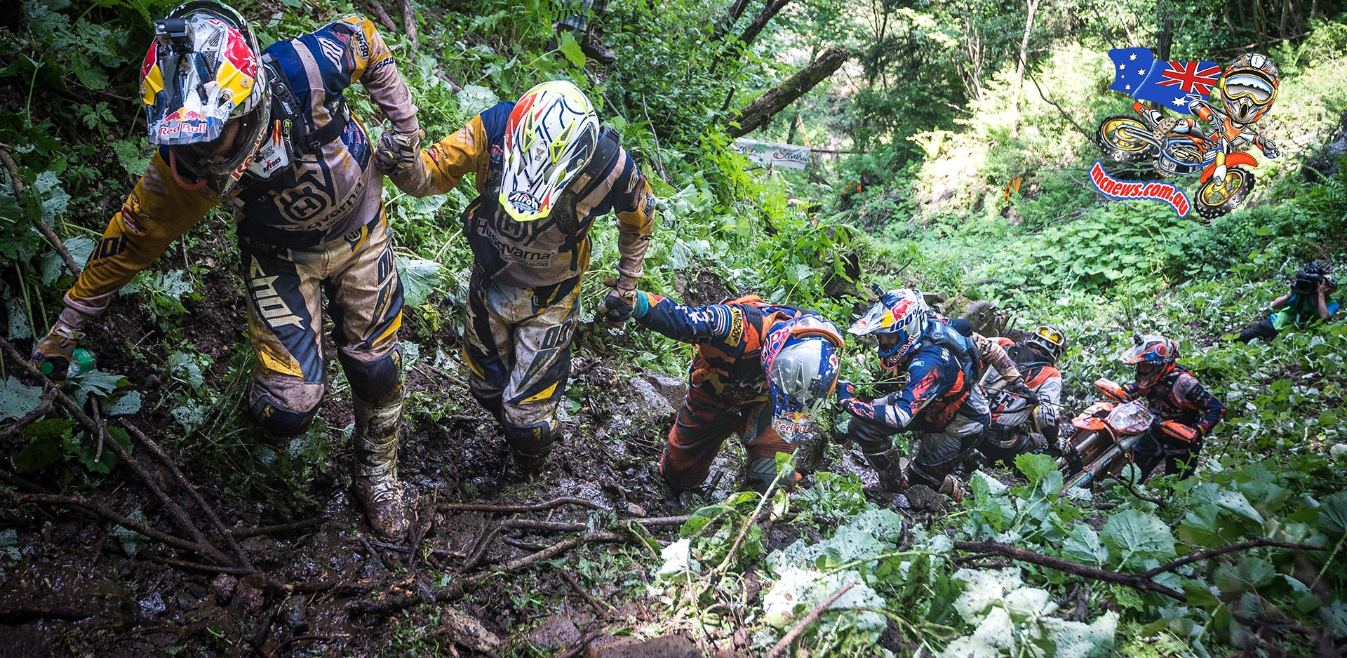 Riders help each other drag their machines up a slope that proved urideable