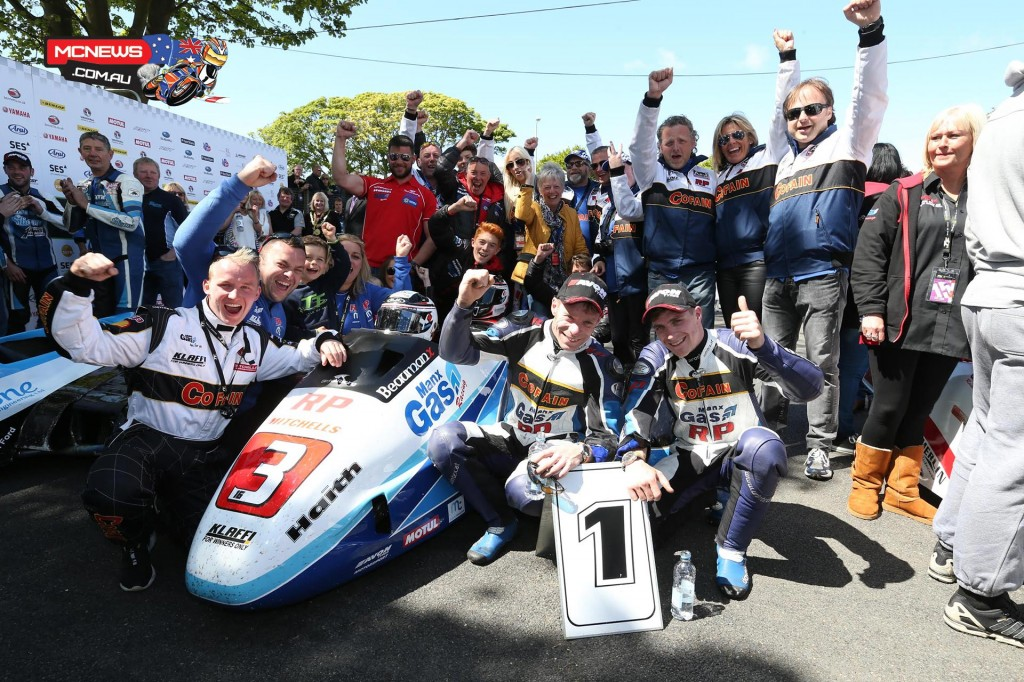 Sure Sidecar Race 1 winners Tom and Ben Birchall with team, family and supporters.