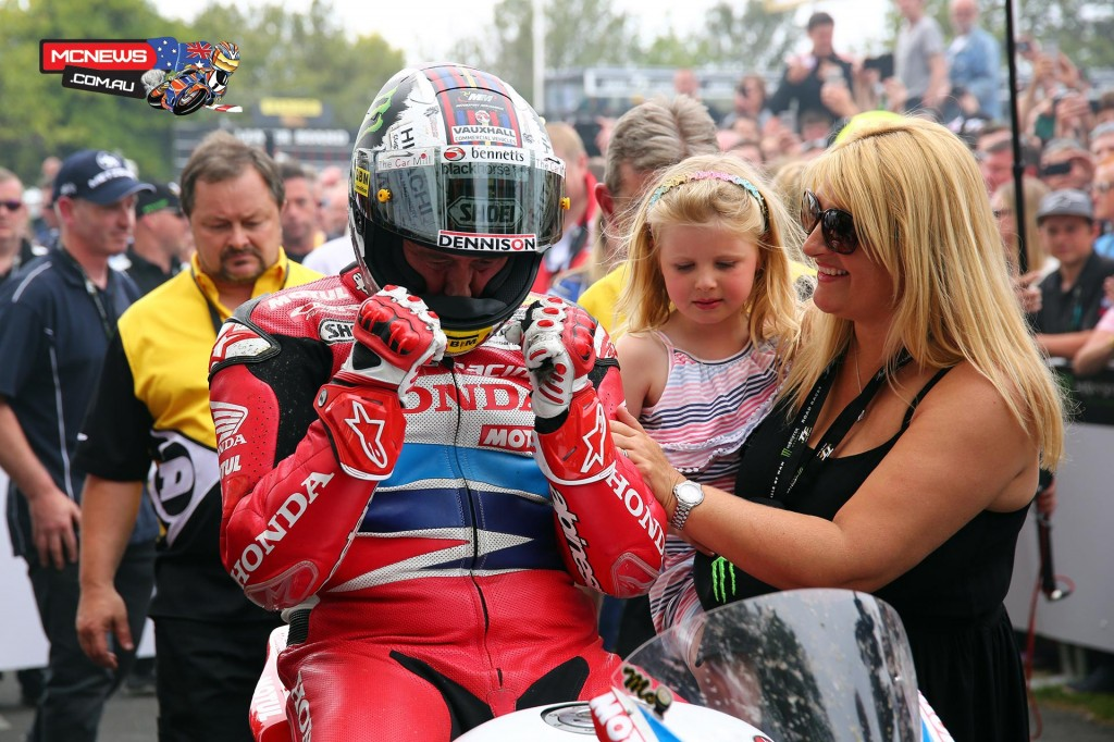John McGuinness, his wife Rebecca and daughter Maisie in the winners enclosure for the 2015 PokerStars Senior TT podium. Credit Tim Keeton/Impact Images Photography