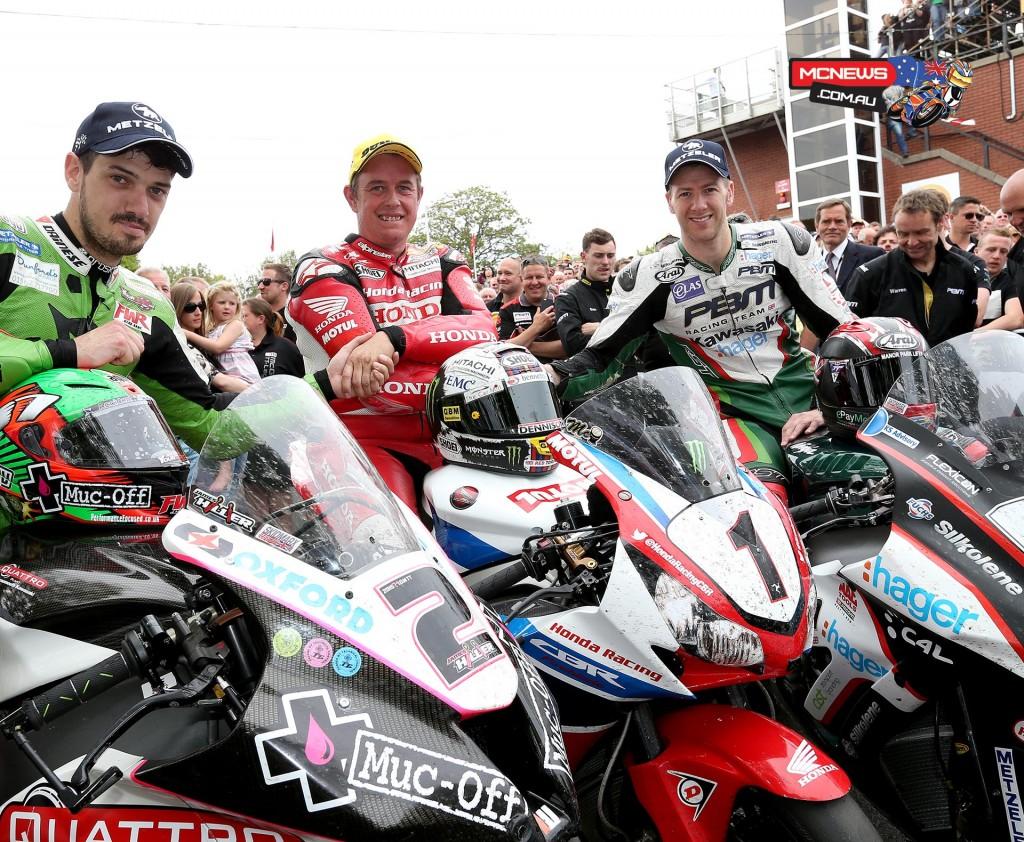 James Hillier, John McGuinness and Ian Hutchinson celebrate in the winners enclosure for the 2015 PokerStars Senior TT podium.