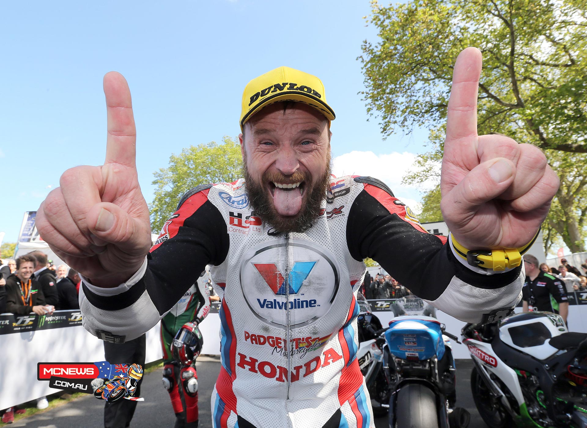 A happy Bruce Anstey celebrates his win in the RST Superbike Race