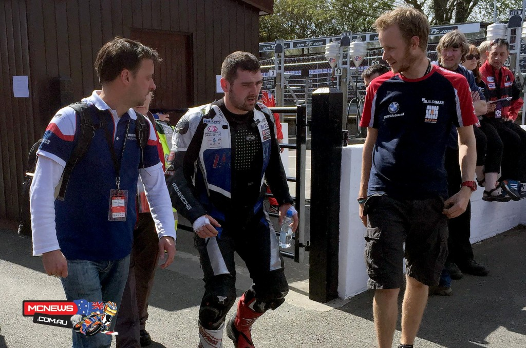 Michael Dunlop walking back to the team garage after being transported back to the pits by ambulance after coming together with a slower rider