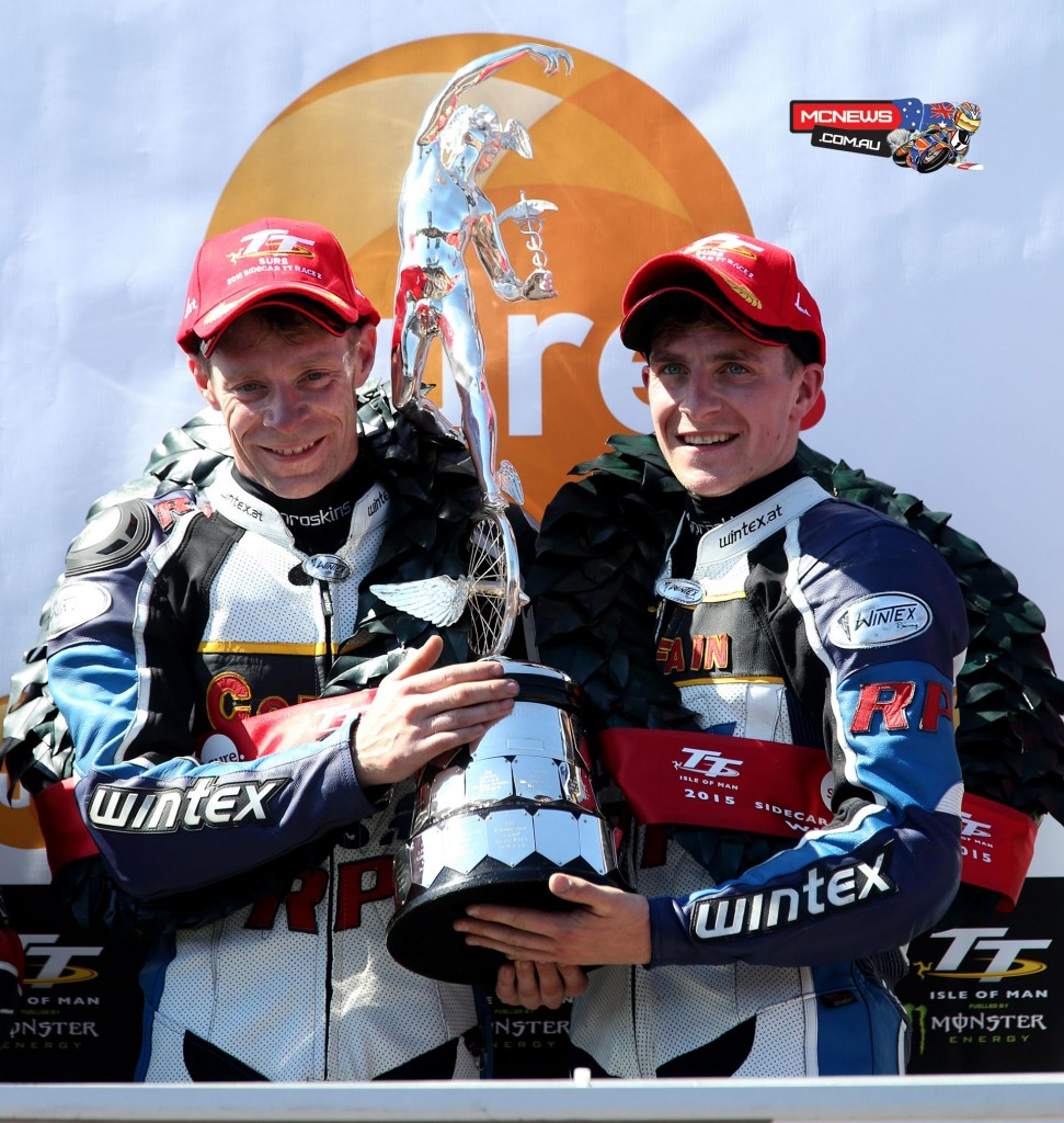 IOM TT 2015 - Sidecar Race Two - Sure Sidecar Race 2 Winners Ben and Tom Birchall on the podium. Credit Pacemaker Press Intl