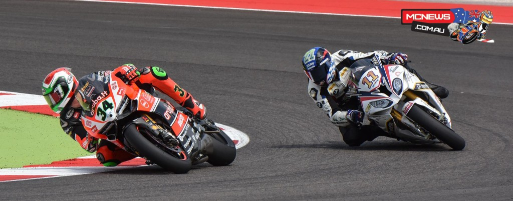 Davide Giugliano chased by wildcard Markus Reiterberger