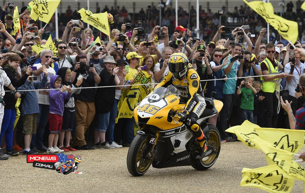 The unveiling of Rossi's bike was followed by the Doctor delighting thousands of spectators when he rode up and down the 1.16-mile Hillclimb in the yellow livery at 11:40 am. The special colour scheme of his YZR-M1 was similar to the one he and Colin Edwards sported ten years ago when they marked Yamaha's 50th anniversary at the Raceway Laguna Seca with a double podium.