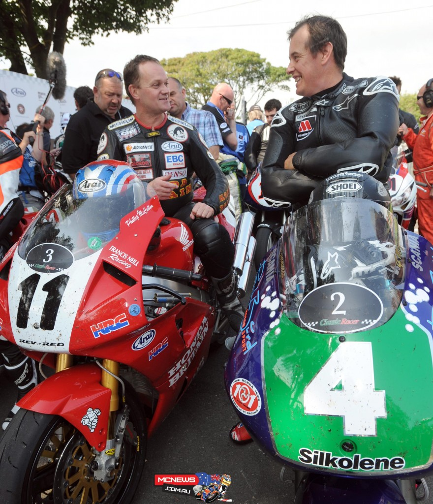 Phillip McCallen and John McGuinness swap tales after the 2013 Classic Racer Lap of Honour