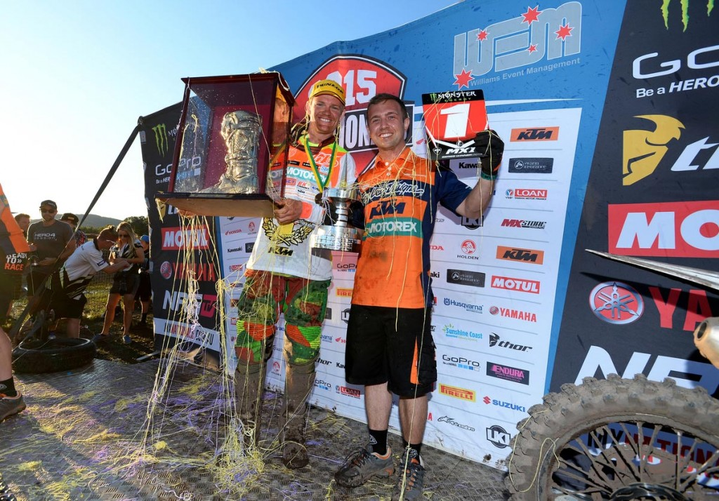 Australia's newest premier class champion Kirk Gibbs savours the moment with Factory team technician Kyle Blunden at Coolum.
