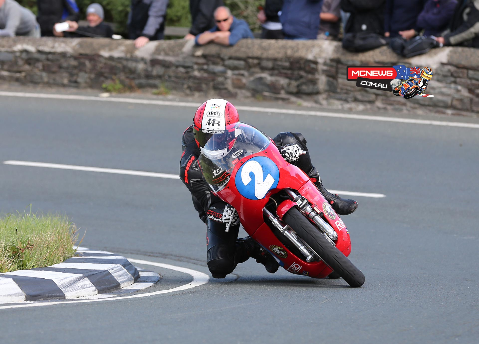 Michael Rutter takes the Gooseneck at speed on his Ripley Land Drixton Honda twin.