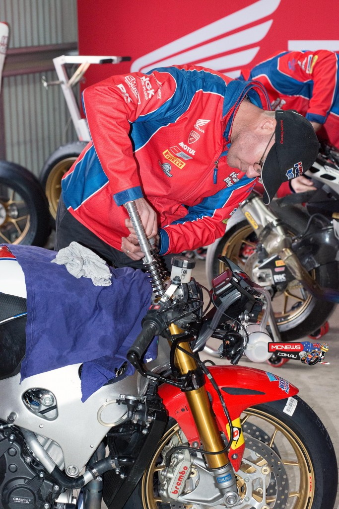 Fork internals being swapped out for a softer set-up in the Fireblade SP machines in preparation for a wet race one. Team Principal Paul Free.