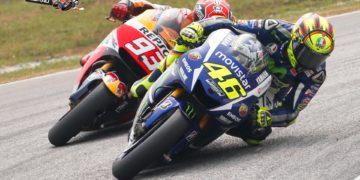 Valentino Rossi and Marc Marquez tussle at Sepang MotoGP 2015