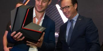Jonathan Rea receives the 2015 WorldSBK title from WSBK Executive Director Javier Alonso