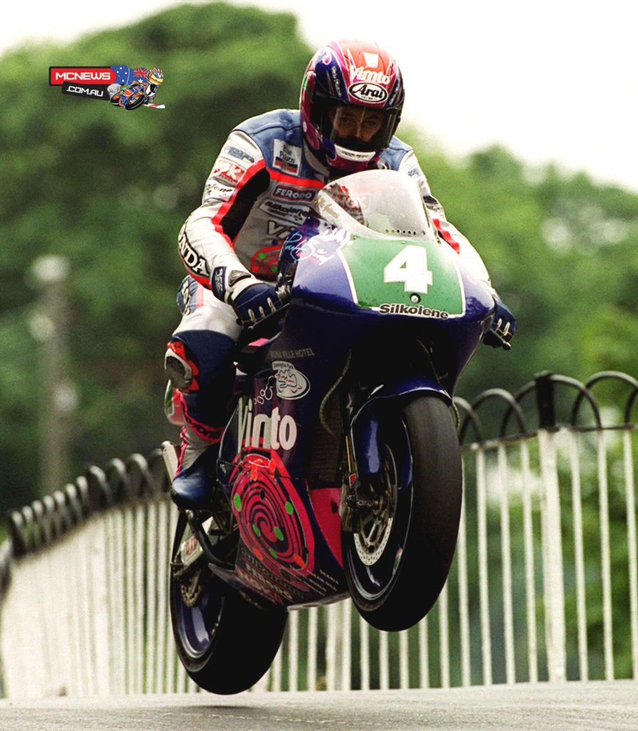 John McGuinness at Ballaugh Bridge on his way to winning the 250cc race