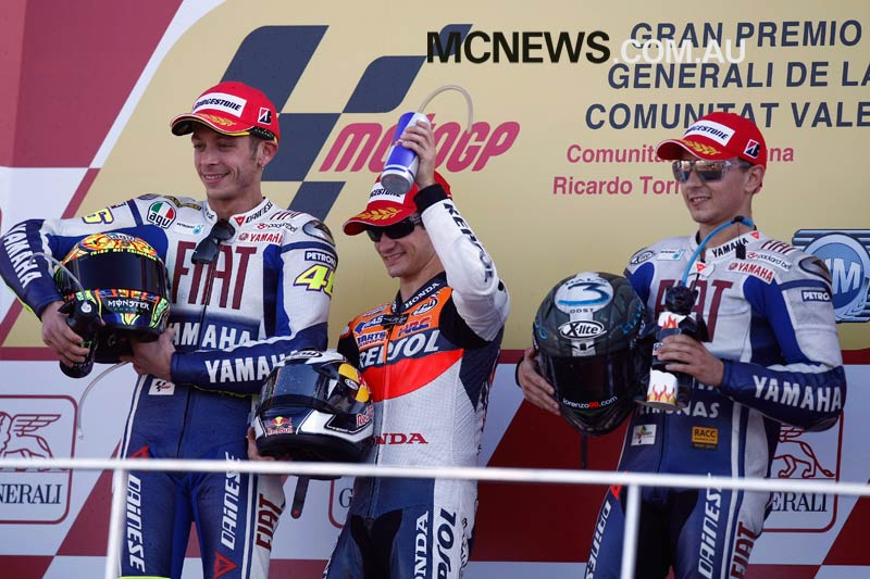 Dani Pedrosa on the top step of the podium at Valencia MotoGP in 2009 ahead of Valentino Rossi and Jorge Lorenzo