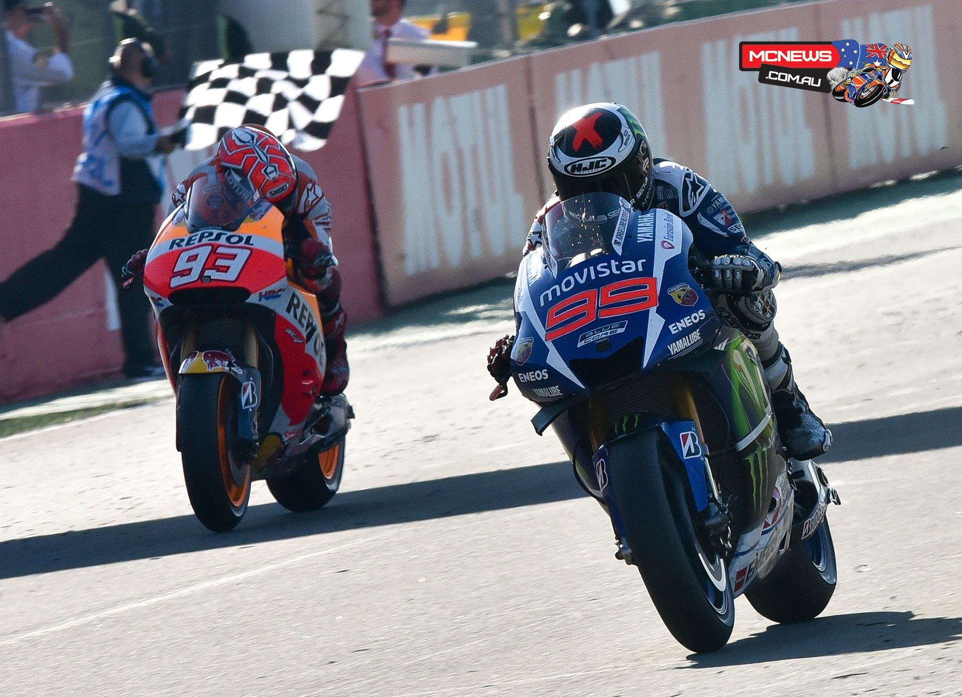 Jorge Lorenzo takes the flag ahead of Marc Marquez
