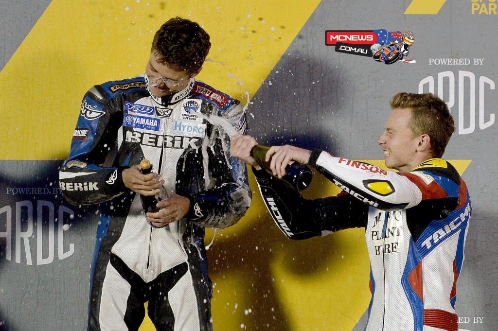 Michael Blair sprays 2015 Supersport Champion Callum Spriggs with the champagne - 2015 Swann Insurance Australasian Superbike Championship - Image by YRD
