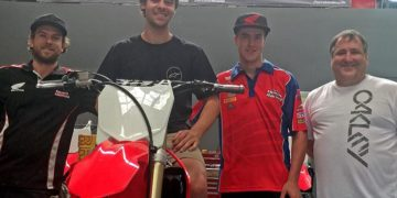 Jay Wilson trying a CRF450R on for size at Team Honda Racing with Technicians Daryl Fenn (on Jay's right), George Rawlings and Pip Harrison.
